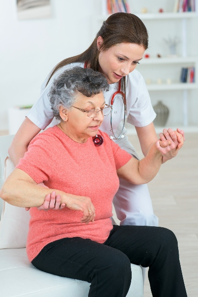 A private duty home care worker assists a client to improve her quality of life.